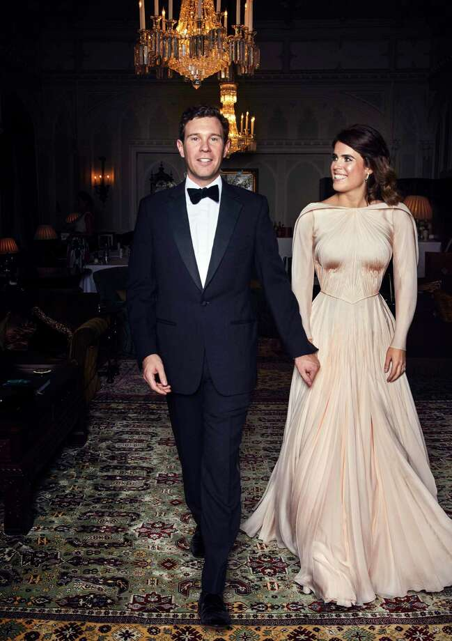 In this photo released on Saturday, Oct. 13 2018 by Buckingham Palace, Britain's Princess Eugenie of York and  Jack Brooksbank are photographed at Royal Lodge, Windsor, England, ahead of the private evening dinner, following their Wedding, at St George's Chapel, Windsor Castle on Friday, Oct. 12, 2018.  (Alex Bramall/Buckingham Palace via AP) Photo: Alex Bramall / Windsor
