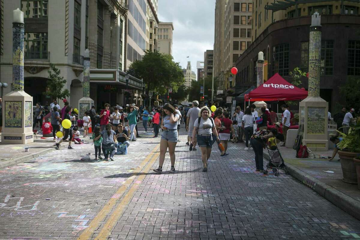 Pedestrians walk up Houston Street during Chalk It Up in downtown San Antonio, Saturday, Oct. 13, 2018. San Antonio ranks 46th amid the top 50 U.S. markets for tech talent, according to a report released this summer. Austin came in at No. 6, Dallas and Ft. Worth at No. 12 and Houston at No. 32.