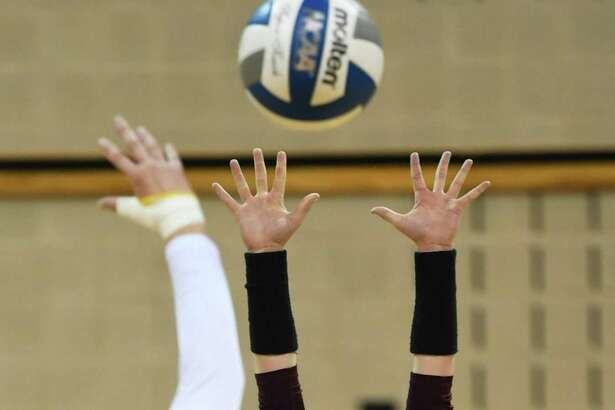TAMIU Annie Deininger plays the net during a game against St. Edwards University on Saturday, Oct. 13, 2018, at TAMIU.
