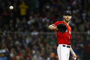 Boston Red Sox starting pitcher Chris Sale (41) pitches during the second inning of Game 1 of the American League Championship Series at Fenway Park on Saturday, Oct. 13, 2018, in Boston.