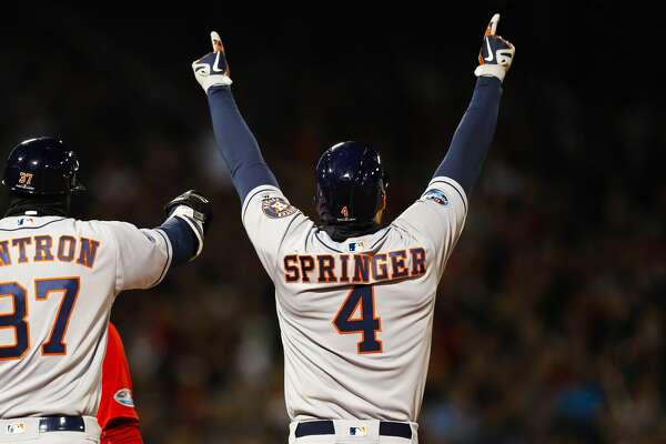 Houston Astros George Springer (4) celebrates his two RBI single during the second inning of Game 1 of the American League Championship Series at Fenway Park on Saturday, Oct. 13, 2018, in Boston.