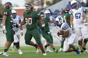 The Woodlands defensive lineman Caleb Fox (90) reacts after hitting Klein running back D'Anthony Simms (23) in the backfield during the second quarter of a District 15-6A high school football game at Woodforest Bank Stadium, Saturday, Oct. 13. 2018, in Shenandoah.