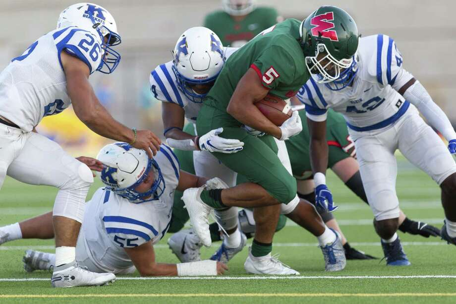 The Woodlands running back Bryeton Gilford (5) is brought down short of the first down maker during the first quarter of a District 15-6A high school football game at Woodforest Bank Stadium, Saturday, Oct. 13. 2018, in Shenandoah. Photo: Jason Fochtman, Houston Chronicle / Staff Photographer / © 2018 Houston Chronicle