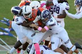 Jonathan Williams (27) of Bush is tackled by Adrian Johnson (25) and Jake Sniffin (10) of Ridge Point in the first quarter of a high school football game between the Bush Broncos and the Ridge Point Panthers on Saturday, October 13, 2018 at Mercer Stadium, Sugar Land, TX.