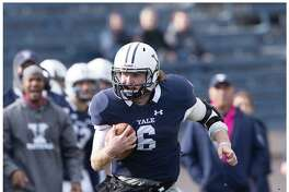 Yale quarterback Kurt Rawlings breaks free during Saturday's game against Mercer.