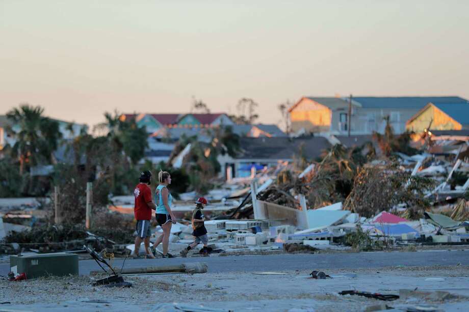 People walk amidst rubble in the aftermath of Hurricane Michael in Mexico Beach, Fla., Saturday, Oct. 13, 2018. (AP Photo/Gerald Herbert) Photo: Gerald Herbert / Copyright 2018 The Associated Press. All rights reserved.