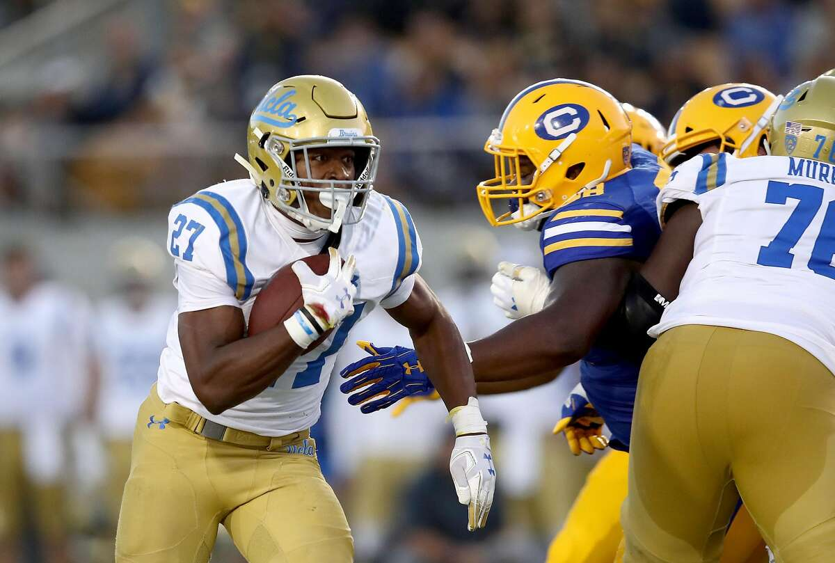 BERKELEY, CA - OCTOBER 13: Joshua Kelley #27 of the UCLA Bruins runs with the ball against the California Golden Bears at California Memorial Stadium on October 13, 2018 in Berkeley, California. (Photo by Ezra Shaw/Getty Images)