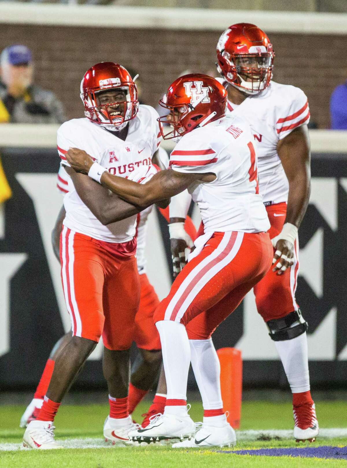 Houston's Courtney Lark, left, celebrates with teammates after scoring during their game against East Carolina on Oct. 13, 2018.