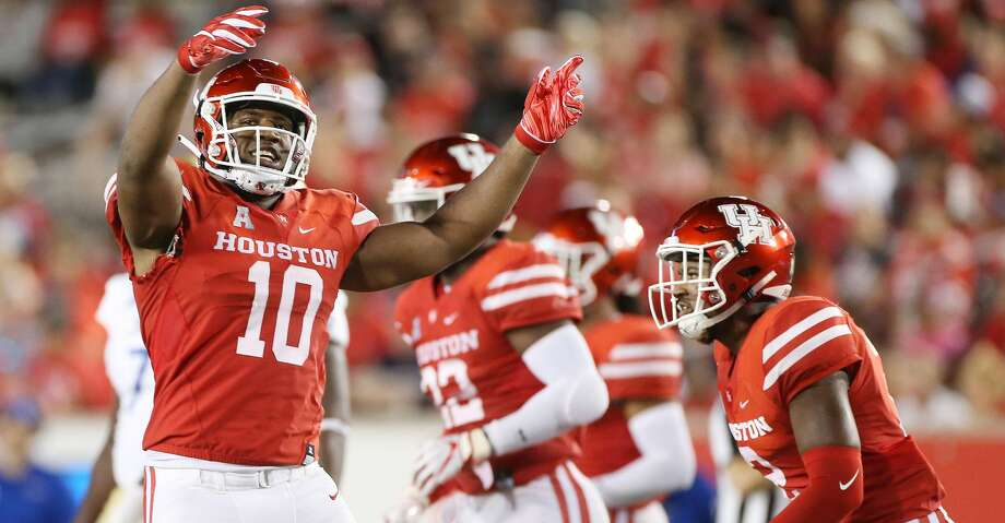 Houston Cougars defensive tackle Ed Oliver (10) fires up the crowd after a Cougar touchdown at TDECU Stadium on Thursday, Oct. 4, 2018 in Houston. Photo: Elizabeth Conley/Staff Photographer
