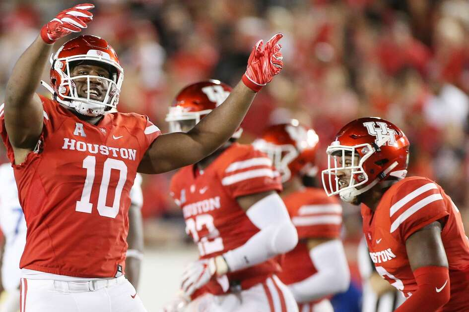 Houston Cougars defensive tackle Ed Oliver (10) fires up the crowd after a Cougar touchdown at TDECU Stadium on Thursday, Oct. 4, 2018 in Houston.