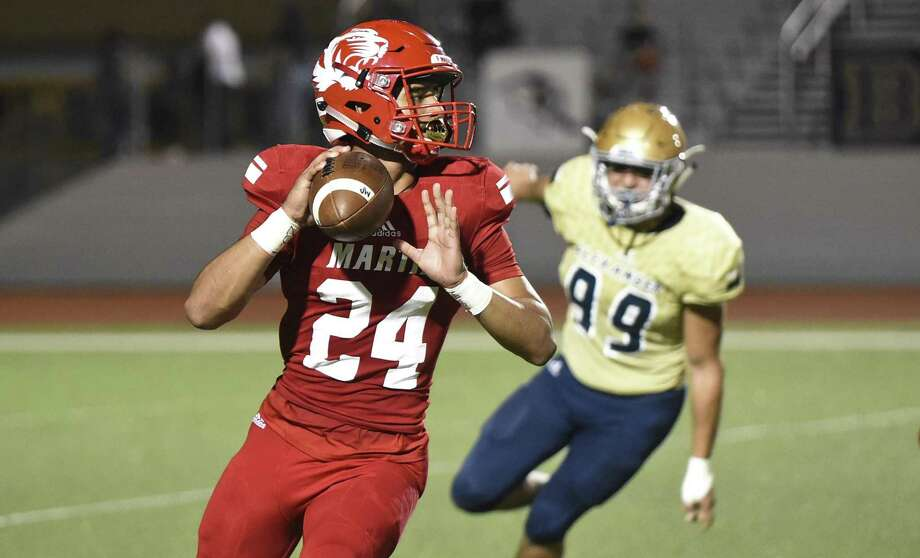 Martin High School Mathew Duron goes for a pass as Chris Muñoz looks to sack Duron Alexander High School during a game on Thursday, Sept. 20, 2018 at Shirley Field. Photo: Danny Zaragoza, Staff Photographer / Laredo Morning Times / Laredo Morning Times
