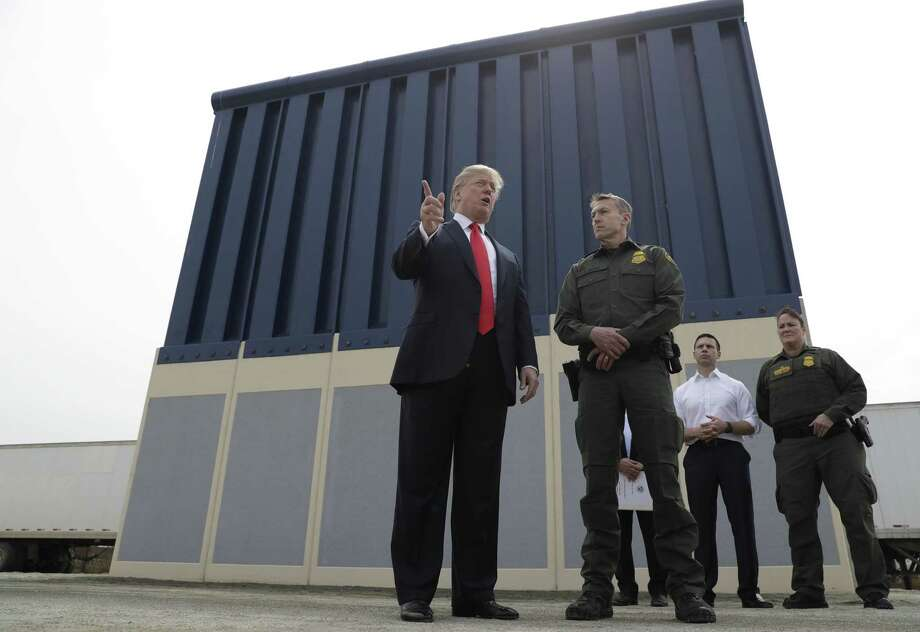 FILE - In this March 13, 2018, file photo, President Donald Trump speaks during as he reviews border wall prototypes, in San Diego, as Rodney Scott, the Border Patrol's San Diego sector chief, listens. Congress is heading toward a post-election showdown over President Donald Trump's border wall, as GOP leaders signal they're willing to engage in hardball tactics that could spark a partial government shutdown and the president revs up midterm crowds for the wall, a centerpiece of his 2016 campaign and a top White House priority. (AP Photo/Evan Vucci, File) Photo: Evan Vucci /Associated Press / Copyright 2018 The Associated Press. All rights reserved.