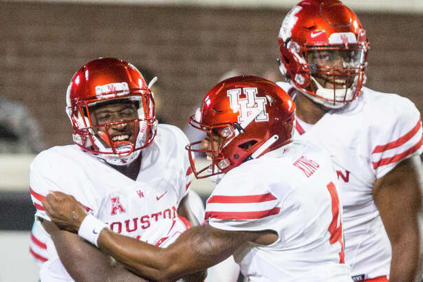 Houston's Courtney Lark, left, celebrates with teammates after scoring during their game against East Carolina on Oct. 13, 2018. (Molly Mathis/The Daily Reflector)