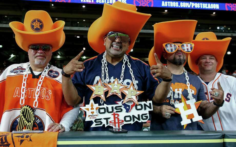 Houston Astros fans, left to right, David Arriasola, Carlos Campos, David Gonzalez, and Chris Yancey pose for a photograph while watching game one of the American League Championship Series at Minute Maid Park Saturday, Oct. 13, 2018, in Houston. Photo: Godofredo A. Vasquez, Staff Photographer / 2018 Houston Chronicle