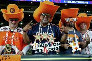Houston Astros fans, left to right, David Arriasola, Carlos Campos, David Gonzalez, and Chris Yancey pose for a photograph while watching game one of the American League Championship Series at Minute Maid Park Saturday, Oct. 13, 2018, in Houston.