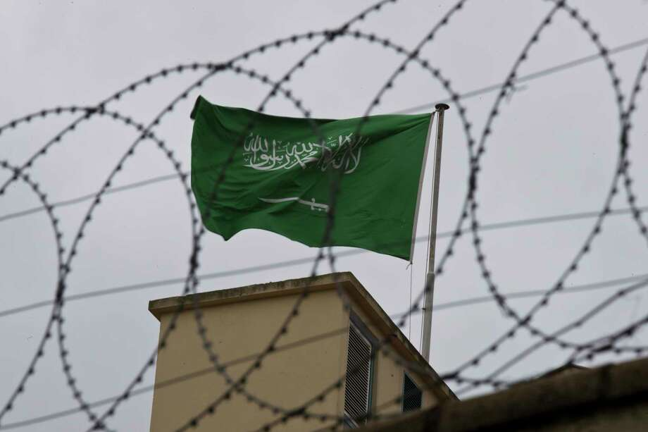 A flag of Saudi Arabia flies behind barb wire, on the roof top of Saudi Arabia's consulate in Istanbul, Saturday, Oct. 13, 2018.  Turkish officials have an audio recording of the alleged killing of journalist Jamal Khashoggi from the Apple Watch he wore when he walked into the Saudi Consulate in Istanbul over a week ago, a pro-government Turkish newspaper reported Saturday. (AP Photo/Petros Giannakouris) Photo: Petros Giannakouris / Copyright 2016 The Associated Press. All rights reserved.