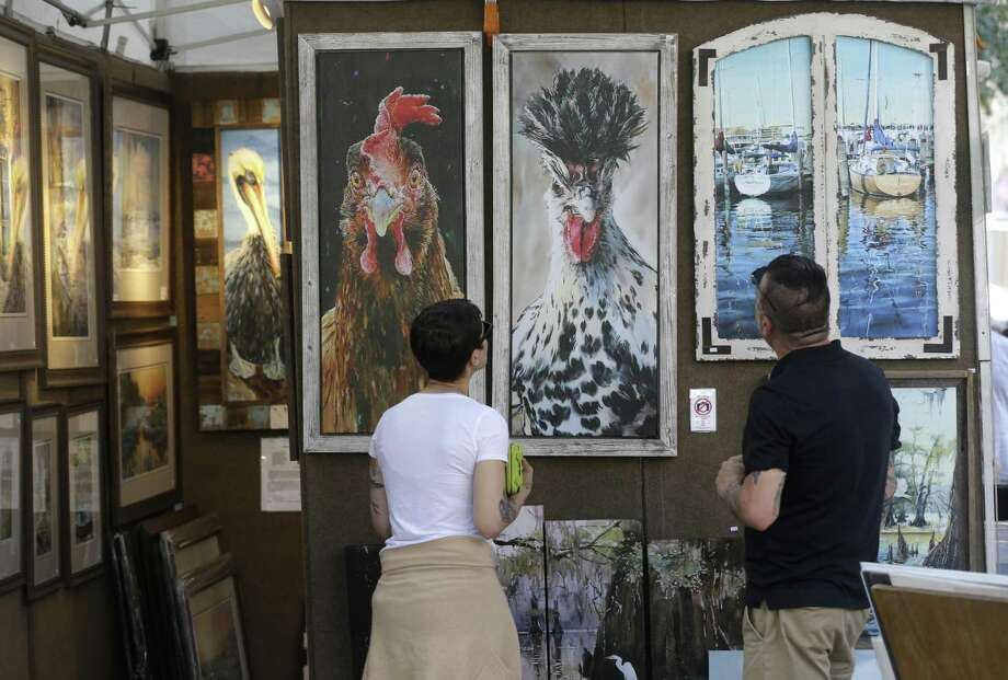 PHOTOS: Art fans spend the day downtown People look at the paintings at the booth of Baton Rouge artist Keith Andry during the Bayou City Arts Festival Saturday, Oct. 13, 2018, in Houston. >>>See who turned out for the Bayou City Arts Festival ... Photo: Melissa Phillip, Houston Chronicle / Staff Photographer / © 2018 Houston Chronicle