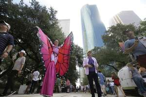 Justine Gingell of Houston with J&D Entertainment performs as an eight foot tall butterfly during the Bayou City Arts Festival Saturday, Oct. 13, 2018, in Houston.