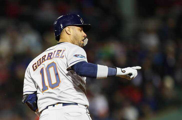 Houston Astros Yuli Gurriel (10) hits a three run home run during the ninth inning of Game 1 of the American League Championship Series at Fenway Park on Saturday, Oct. 13, 2018, in Boston.