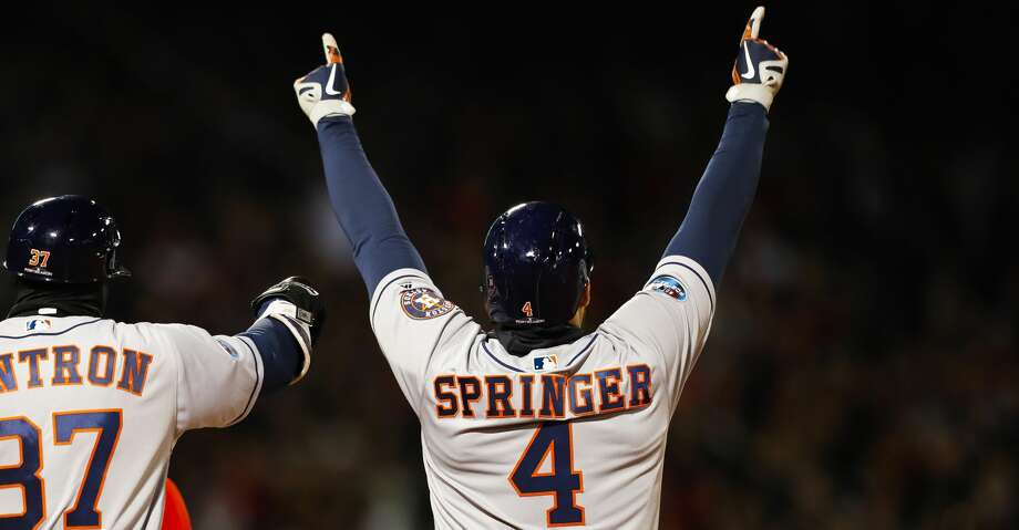 Houston Astros George Springer (4) celebrates his two RBI single during the second inning of Game 1 of the American League Championship Series at Fenway Park on Saturday, Oct. 13, 2018, in Boston. Photo: Brett Coomer/Staff Photographer