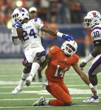 3of8UTSA quarterback Cordale Grundy tackles Louisiana Tech defender  L Jarius Sneed (24) after Sneed intercepted a pass during college football  action in the ... c3ed57587