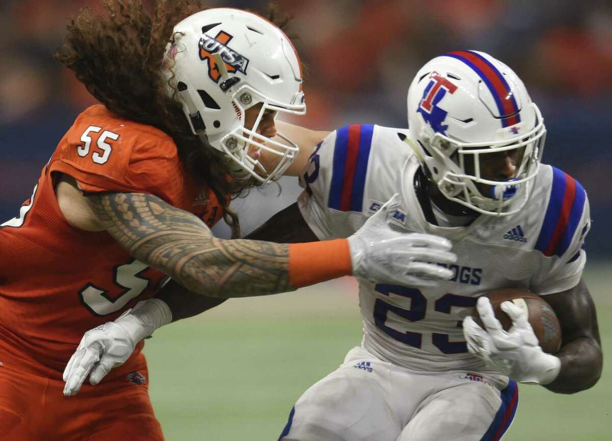 UTSA linebacker Josiah Tauaefa defends as Jaqwis Dance of Louisiana Tech runs for yardage during college football action in the Alamodome on Saturday, Oct. 13, 2018.