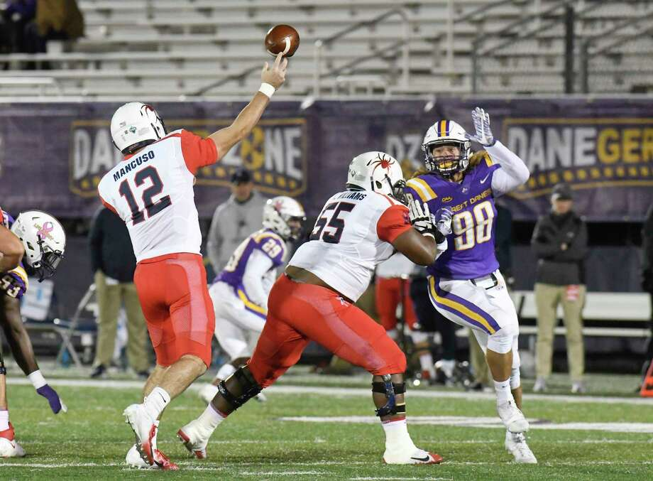 University at Albany defensive lineman Dean Grogg (98) try's to block a pass attempt by Richmond quarterback Joe Mancuso (12) while being defended by  offensive lineman Kolby Williams (55) during the first half of an NCAA college football game Saturday, Oct. 13, 2018, in Albany, N.Y. (Hans Pennink / Special to the Times Union) Photo: Hans Pennink / Hans Pennink