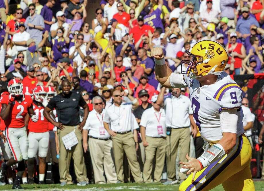 LSU quarterback Joe Burrow (9) celebrates a touchdown against Georgia in the first half of an NCAA college football in Baton Rouge, La., Saturday, Oct. 13, 2018. (AP Photo/Matthew Hinton) Photo: Matthew Hinton / FR 170690AP