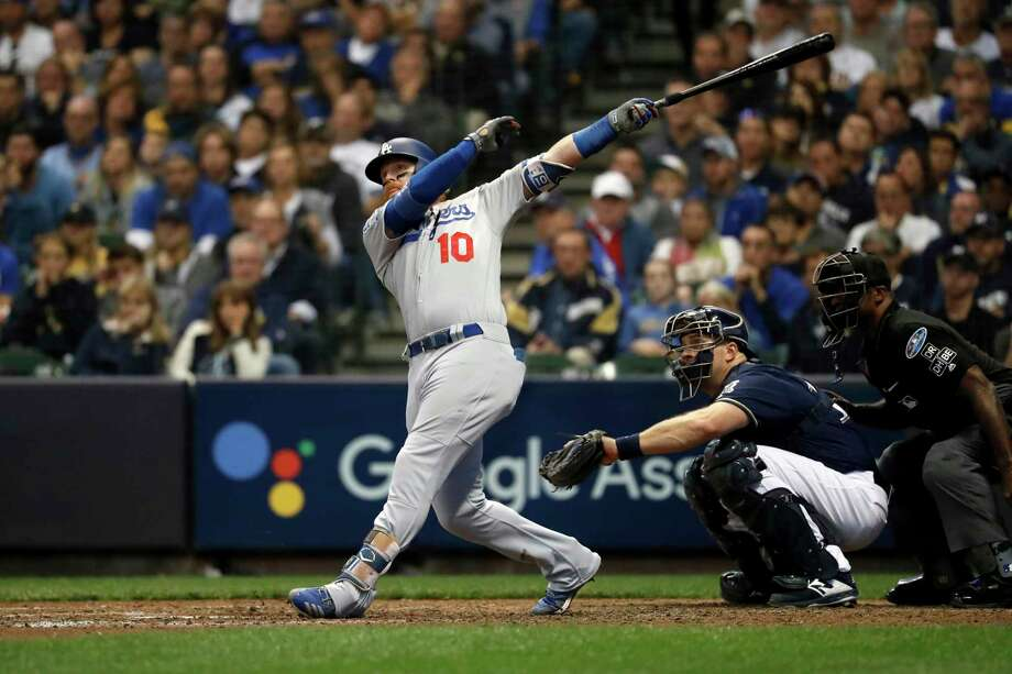 Los Angeles Dodgers' Justin Turner (10) hits a two-run home run during the eighth inning of Game 2 of the National League Championship Series baseball game against the Milwaukee Brewers Saturday, Oct. 13, 2018, in Milwaukee. (AP Photo/Jeff Roberson) Photo: Jeff Roberson / Copyright 2018 The Associated Press. All rights reserved.