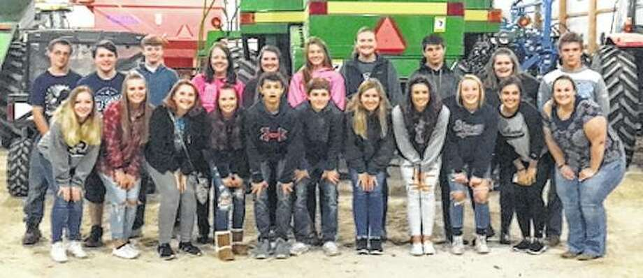 The Bluffs FFA chapter had its annual fall cookout and bonfire Oct. 6, hosted by the family of Anna Merriman. In all, 21 members attended. Photo: Photo Provided