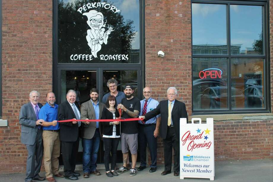 Perkatory Coffee Roasters Owners held a grand opening Oct. 10 at 725 Main St., Middletown. From left are Middlesex County Chamber of Commerce President Larry McHugh, Chief Building Official Dean Lisitano, Chamber Chairman Jay Polke, Mayor Dan Drew, Building Owner Keith Emery, Perkatory Owners Johanna and Joey Perazella, Economic Development Specialist Tom Marano and Chamber Small Business Counselor Paul Dodge. Photo: Contributed Photo