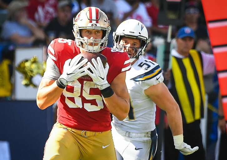 CARSON, CA - SEPTEMBER 30: Tight end George Kittle #85 of the San Francisco 49ers catches the ball for a touchdown against the Los Angeles Chargers at StubHub Center on September 30, 2018 in Carson, California. (Photo by Jayne Kamin-Oncea/Getty Images)