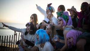 Hilary Nash (top) and others pose at Treasure Island Music Festival on Saturday, Oct. 13, 2018, in Oakland, Calif.