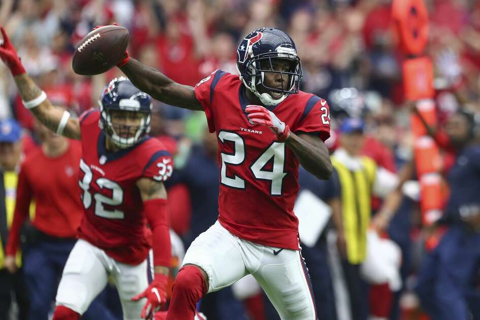 Houston Texans cornerback Johnathan Joseph (24) returns an interception for the winning touchdown during the fourth quarter of an NFL game against the Buffalo Bills at NRG Stadium Sunday, Oct. 14, 2018, in Houston. The Texans won 20-13.