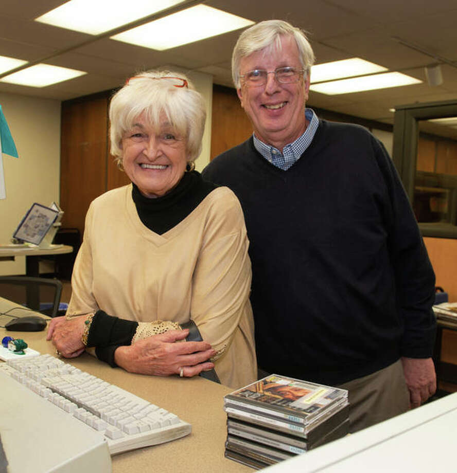 Ann and Richard Moss smile behind Lovejoy Library's circulation desk, the place they first met more than 50 years ago. Photo: For The Telegraph