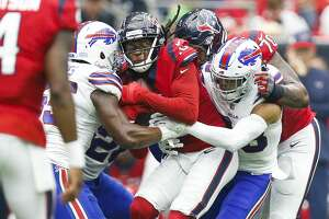 Buffalo Bills defensive end Jerry Hughes (55) and strong safety Micah Hyde (23) wrap up Houston Texans wide receiver DeAndre Hopkins (10) during the first half as the Houston Texans take on the Buffalo Bills at NRG Stadium Sunday Oct. 14, 2018 in Houston.