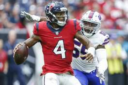 Houston Texans quarterback Deshaun Watson (4) is pursued by Buffalo Bills defensive end Jerry Hughes (55) during the third quarter as the Houston Texans take on the Buffalo Bills at NRG Stadium Sunday Oct. 14, 2018 in Houston.