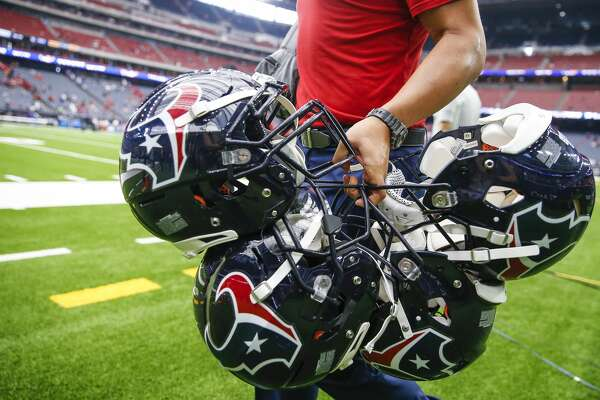 A Houston Texans staff member walks off the field with helmets after the Houston Texans beat the Buffalo Bills 20-13 at NRG Stadium Sunday Oct. 14, 2018 in Houston.
