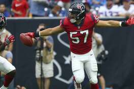 Houston Texans linebacker Brennan Scarlett (57) celebrates after recovering the ball after a muffed punt during the first quarter of an NFL game against the Buffalo Bills at NRG Stadium Sunday, Oct. 14, 2018, in Houston.