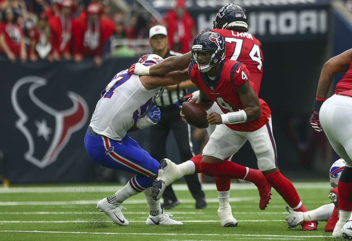 Houston Texans quarterback Deshaun Watson (4) escapes the pocket during the first quarter of an NFL game against the Buffalo Bills at NRG Stadium Sunday, Oct. 14, 2018, in Houston. The Texans won 20-13.