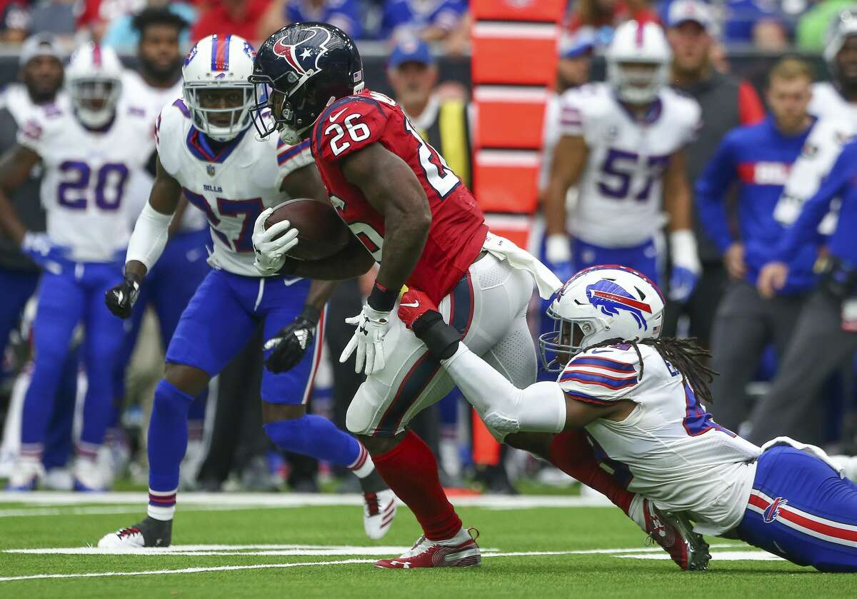 Houston Texans running back Lamar Miller (26) rushes the ball against Buffalo Bills linebacker Tremaine Edmunds (49) during the fourth quarter of an NFL game at NRG Stadium Sunday, Oct. 14, 2018, in Houston. The Texans won 20-13.
