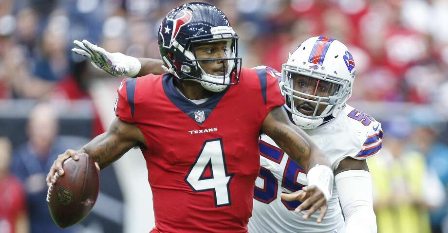 4c79784c1 Houston Texans quarterback Deshaun Watson (4) is pursued by Buffalo Bills  defensive end Jerry