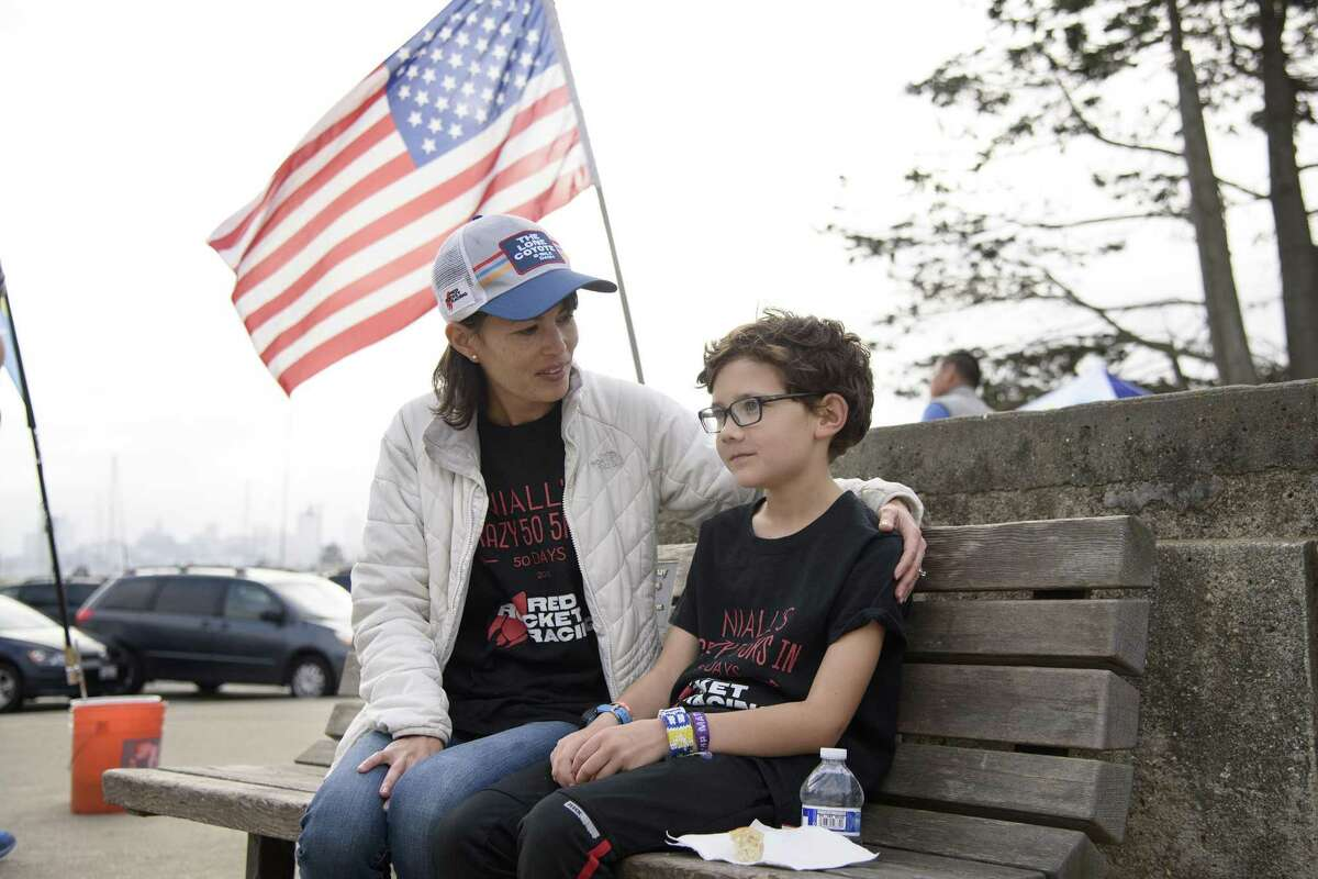 Niall McDermott, right, talks with his mom Maggie McDermott after finishing his 50th 5K race in 50 days for charity at Crissy Field in San Francisco, Calif., on Sunday October 14th, 2018.