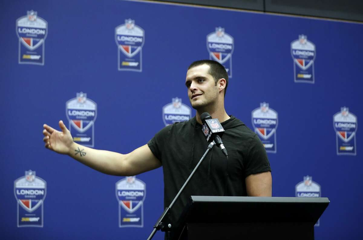 Oakland Raiders quarterback Derek Carr (4) gestures during a press conference after an NFL football game against Seattle Seahawks at Wembley stadium in London, Sunday, Oct. 14, 2018. Seattle Seahawks won the match 27-3. (AP Photo/Matt Dunham)