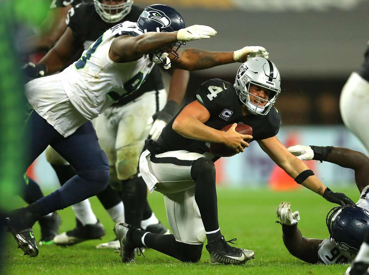 LONDON, ENGLAND - OCTOBER 14: Derek Carr of the Oakland Raiders is injured in a tackle during the NFL International Series game between Seattle Seahawks and Oakland Raiders at Wembley Stadium on October 14, 2018 in London, England. (Photo by Warren Little/Getty Images)