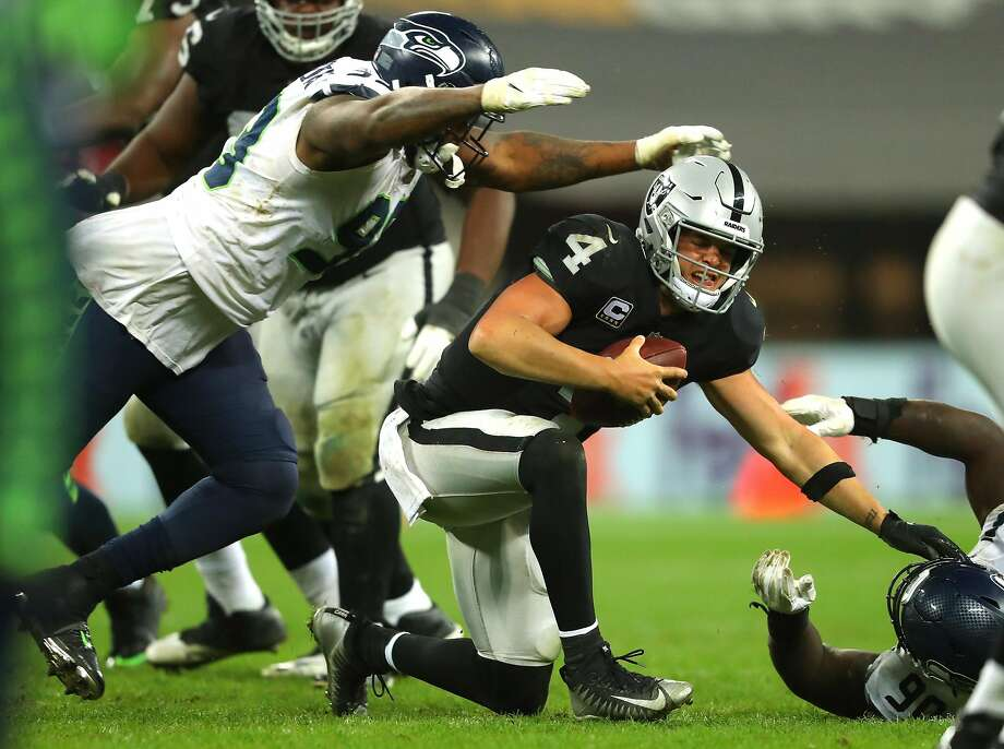 LONDON, ENGLAND - OCTOBER 14: Derek Carr of the Oakland Raiders is injured in a tackle during the NFL International Series game between Seattle Seahawks and Oakland Raiders at Wembley Stadium on October 14, 2018 in London, England. (Photo by Warren Little/Getty Images) Photo: Warren Little / Getty Images