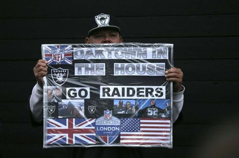 An Oakland Raiders supporter poses for a photo on Wembley Way before an NFL football game against Seattle Seahawks at Wembley stadium in London, Sunday, Oct. 14, 2018. (AP Photo/Tim Ireland) Photo: Tim Ireland / Associated Press