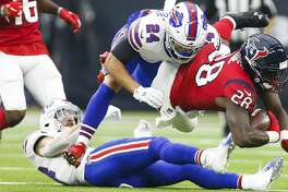 Houston Texans running back Alfred Blue (28) is tackled by Buffalo Bills cornerback Taron Johnson (24) during the first half as the Houston Texans take on the Buffalo Bills at NRG Stadium Sunday Oct. 14, 2018 in Houston.