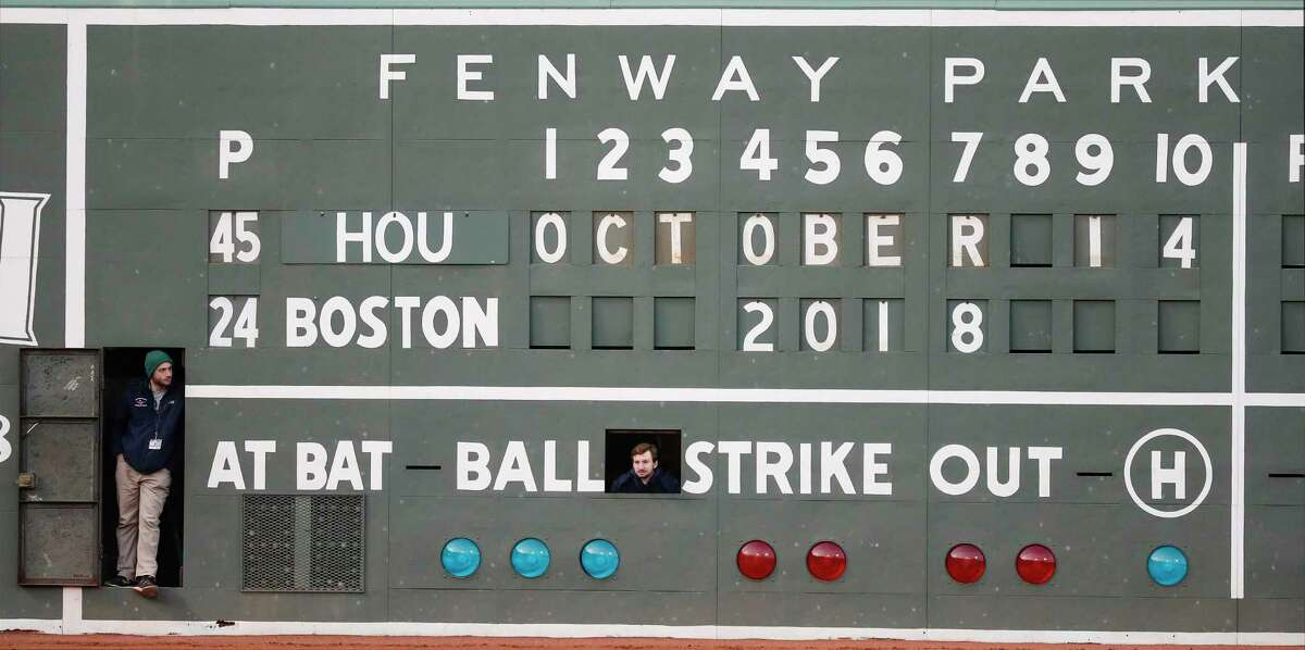 PHOTOS: ALCS, Game 3 Boston Red Sox scoreboard operators stand in openings on the scoreboard on the Green Monster before Game 2 of the American League Championship Series against the Houston Astros at Fenway Park on Sunday, Oct. 14, 2018, in Boston. >>>See photos of the Astros in action against the Red Sox during Game 3 of the American League Championship Series on Tuesday ...