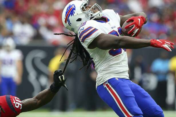 Houston Texans linebacker Jadeveon Clowney (90) tackles Buffalo Bills running back Chris Ivory (33) by the dreadlocks during the fourth quarter of an NFL game at NRG Stadium Sunday, Oct. 14, 2018, in Houston. The Texans won 20-13.